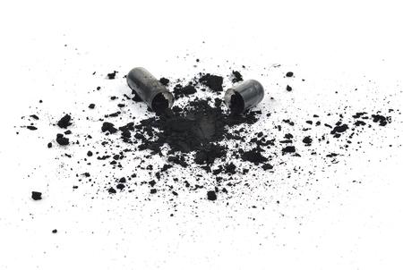Charcoal capsules isolated on white background photo