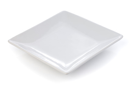 plates of food: empty white plate on a white background