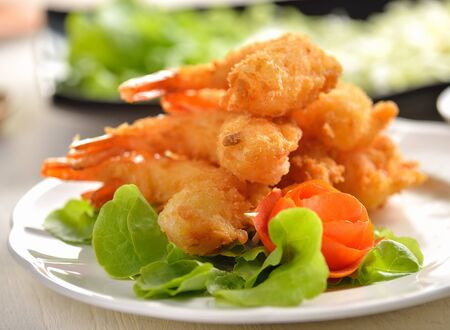 Fried Shrimp with vegetable on white plate photo
