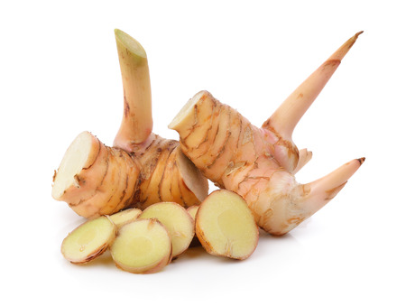 fresh galangal on a white background