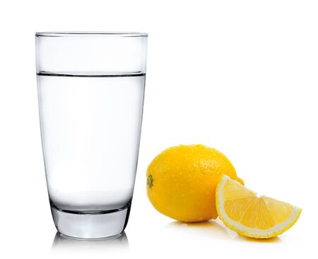 water with lemon on white background photo