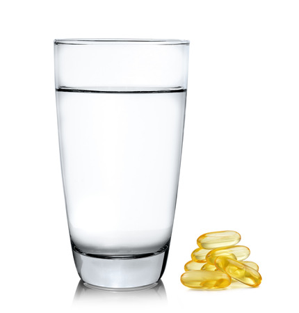 mental object: Glass of water and fish oil isolated on white background