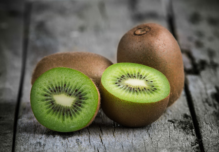 Kiwi fruit on old wooden