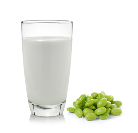 milk with soy beans on white background photo