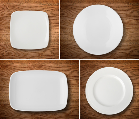 plate: Empty white plates on wooden table Stock Photo