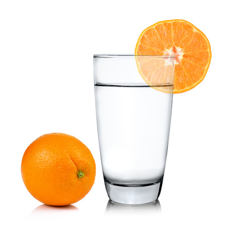 cocktail glasses: Glass of water with orange fruits Stock Photo