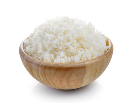 rice in wood bowl on white background
