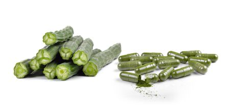 medical questions: Moringa capsule pills on white background