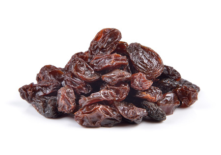 Dried raisins on a white background