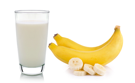 glass of milk and banana isolated on white background