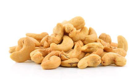cashew nuts heap on white background