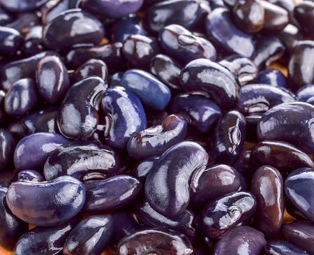 black beans: black beans on wood Stock Photo