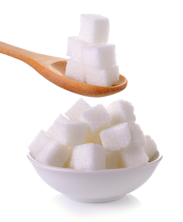 sugar: sugar cube in the spoon and bowl on white background Stock Photo