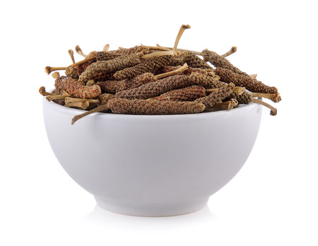 long: long pepper in the bowl on white background