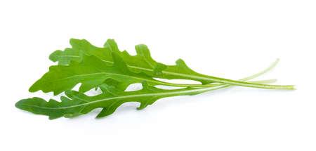 rocket lettuce: Sweet rucola salad or rocket lettuce leaves isolated on white background Stock Photo