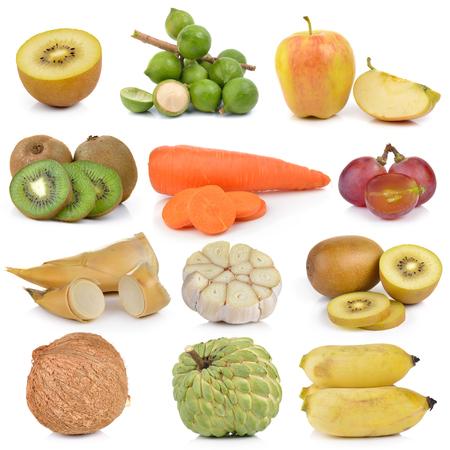 custard apples: Kiwi, macadamia, nuts, grapes, apples, carrots, asparagus, garlic, lemon, coconut custard, banana on white background Stock Photo