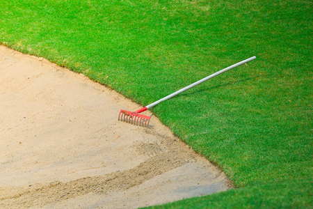 putting: bunker and putting green Stock Photo