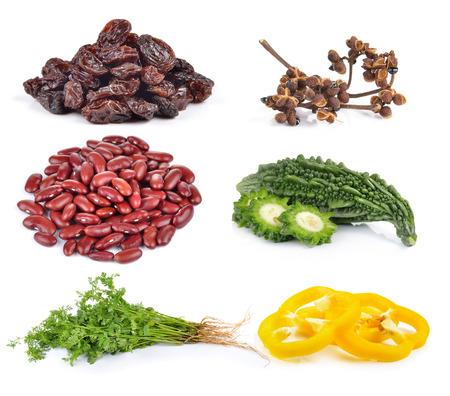 bitter melon: paprika, coriander, Bitter melon, red beans, Zanthozylum, raisins on white background
