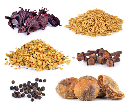 Dried figs, pepper corn, chili seeds, Spice cloves, rice grains, Dried okra on white background