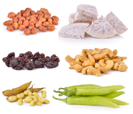 soy bean: soy bean, Dried raisins, chili pepper, Cashews, slice taro root, peanats on white background Stock Photo