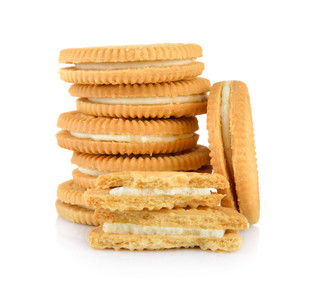 cookies and cream: sandwich cookies with cream on white background