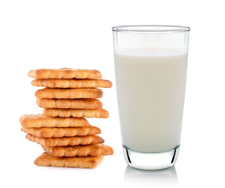 biscuits: glass of milk and butter biscuits on white background