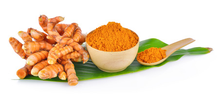 tumeric: turmeric root and dry tumeric in wood bowl on white background Stock Photo