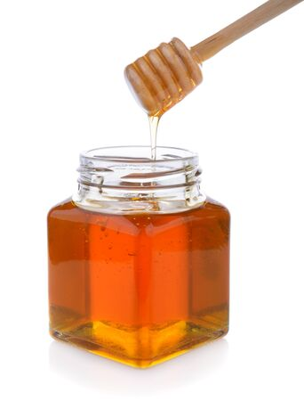 drizzler: Honey with wooden honey dipper on jar