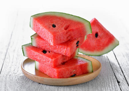 sliced watermelon: water melon in wood plate on table