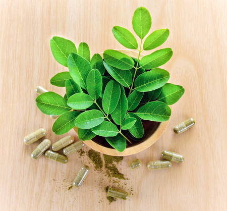 Moringa leaves and capsules (Herbs for health)