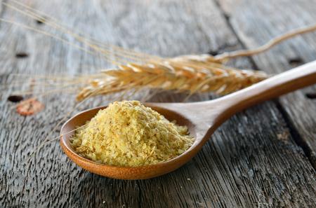 Wheat germ in wood spoon
