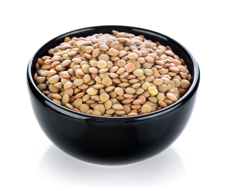 lentils in a bowl on white background