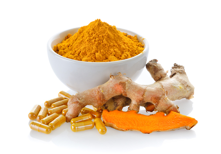 Turmeric powder and turmeric capsules on white background Stock Photo