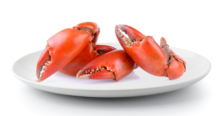 Boiled crab claws in a plate isolated on a white background