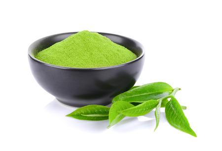 緑茶の粉と白い背景で隔離の葉 写真素材