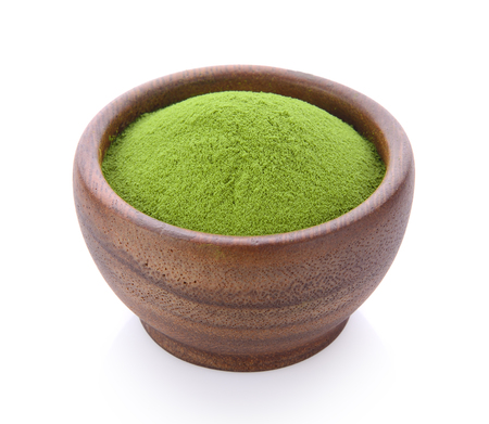 green tea powder in wood bowl on white background Stock Photo