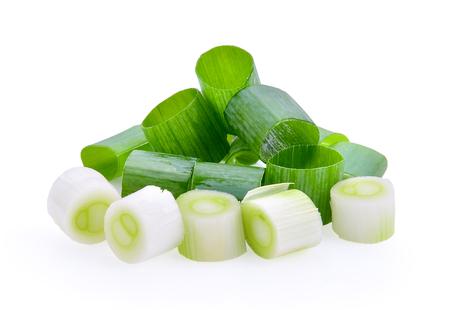 cebollines: chopped green onions on white background Foto de archivo