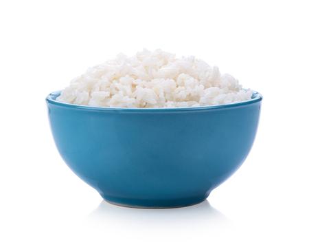 Rice in a bowl on white background Foto de archivo