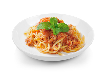 spaghetti pasta with tomato beef sauce in plate on white background
