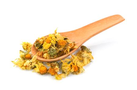 dried chrysanthemum flowers in wood spoon
