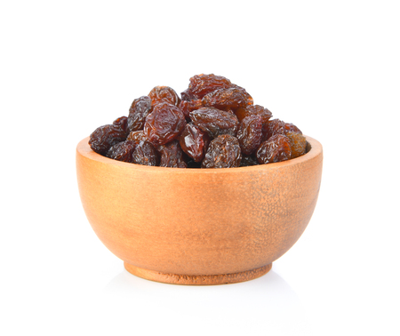 raisin on wood bowl isolated on white background