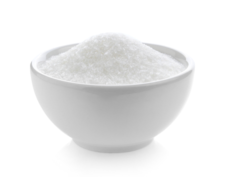 monosodium glutamate in bowl on white background Stock Photo