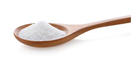monosodium glutamate in wood spoon on white background