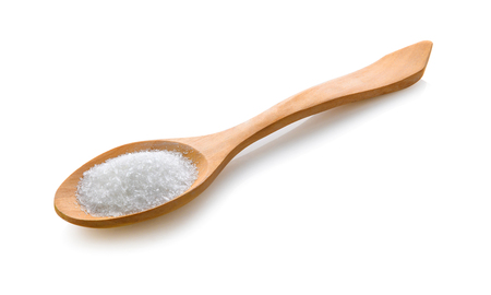 monosodium glutamate in wood spoon on white background