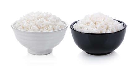Cooked rice in ceramic bowl on white background Archivio Fotografico