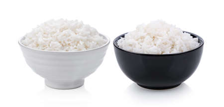 Cooked rice in ceramic bowl on white background Imagens