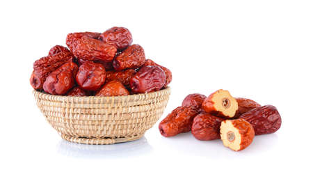 Dried red date or Chinese jujube in basket on white background