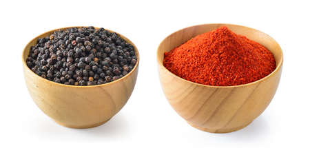 black pepper and chili powder in wood bowl on white background Imagens