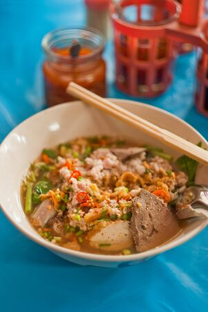Pork noodle soup with seasoning photo