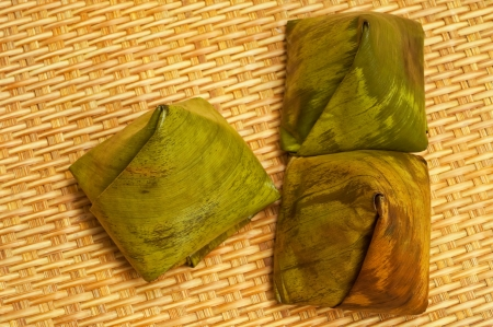 Thai desserts wrapped in banana leaf Stock Photo - 14191461